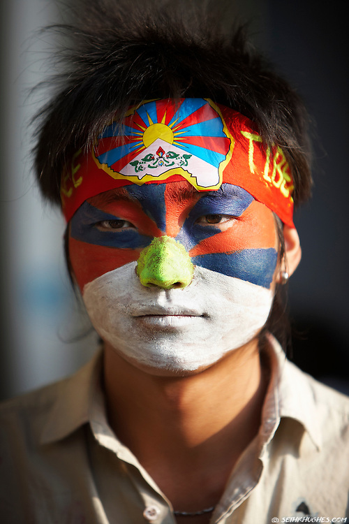 A Tibetan activist with a Tibetan flag representing his native land painted on his face in McLeodGanj, Dharamsala, India.