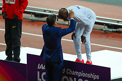 London, 2017-August-04. Lord Sebastian Coe hangs Mo Farah's gold medal around his neck after his victory in the Men's 10,000m final at the IAAF World Championships London 2017. Paul Davey.