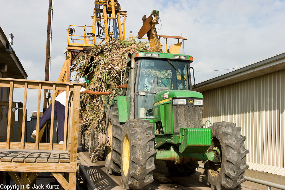 15 NOVEMBER 2005 - FRANKLIN, LA: Sugar cane is delivered to the St. Mary Sugar Co-Op Mill near Franklin, Louisiana during the 2005 sugar cane harvest. Louisiana is one of the leading sugar cane producing states in the US and the economy in southern Louisiana, especially St. Mary and Iberia Parishes, is built around the cultivation of sugar. The mill employs about 180 people. The two mills near Franklin contribute about $150 million (US) to the local economy. Sugar growers in the area are concerned that trade officials will eliminate sugar price supports during upcoming trade talks for the proposed Free Trade Area of the Americas (FTAA). They say elimination of price supports will devastate sugar growers in the US and the local economies of sugar growing areas. They also say it will ultimately lead to higher sugar prices for US consumers.  PHOTO BY JACK KURTZ