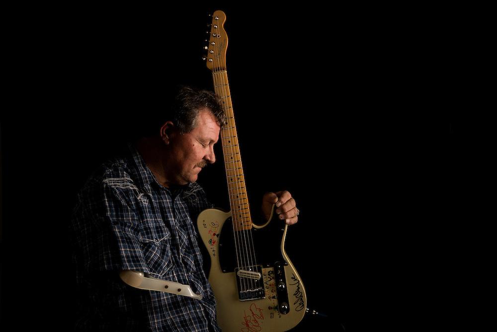 John Allen, guitarist. Photographed in San Antonio, Texas for Texas Prosthetics Center, Inc. on February 17, 2015. Photograph © 2015 Darren Carroll.