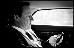 The Prime Minister David Cameron checks his Blackberry while traveling back in his car to his West Oxfordshire office during the Libya crisis, Friday April 15, 2011. Photo By Andrew Parsons / i-Images