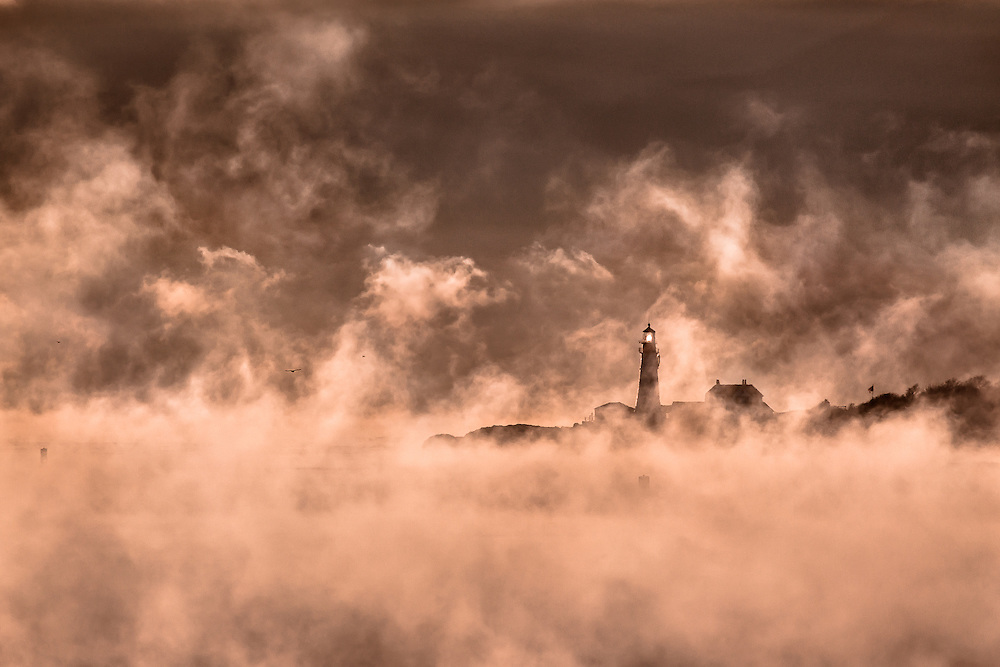 The conditions couldn't have been better to capture some sea smoke from Fort Preble in South Portland. By climbing up onto the old battlements, I was able to get a clear line of sight to Portland Head Light. I used a 400mm lens to compress the scene and draw in the lighthouse. This also made it possible to have a nice dark background because of the cloud bank that was low on the horizon.