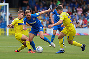AFC Wimbledon midfielder Scott Wagstaff (7) taking on Wycombe Wanderers defender Joe Jacobson (3) and Wycombe Wanderers midfielder Dominic Gape (4) during the EFL Sky Bet League 1 match between AFC Wimbledon and Wycombe Wanderers at the Cherry Red Records Stadium, Kingston, England on 31 August 2019.