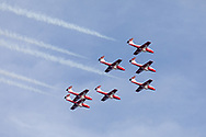 Canadian Snowbirds in the Arrow formation with smoke.  The Snowbirds are also known as the 431 Air Demonstration Squadron and fly the Canadair CT-114 Tutor jet. Photographed during the Canada 150 celebrations in White Rock, British Columbia, Canada.