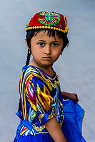 A Uyghur girl wearing traditional clothing, Turpan, Xinjiang Province, China. Turpan is a small oasis town and former Silk Road outpost. Uyghur people are a Central Asian people of Muslim Turkic origin. They are China's largest minority group.