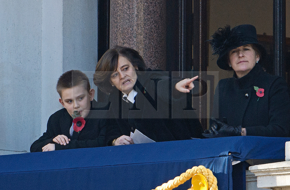 © London News Pictures. 11/11/2012. London, UK. Cherie Blair (centre) wife of former British Prime Minister Tony Blair with her son Leo Blair look on during the Remembrance Day Ceremony at the Cenotaph on November 13, 2011 in London, United Kingdom. Politicians and Royalty joined the rest of the county in honouring the war dead by gathering at the iconic memorial to lay wreaths and observe two minutes silence. Photo Credit: Ben Cawthra/LNP