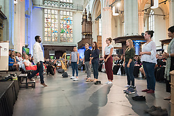 23 August 2018, Amsterdam, Netherlands: Youth participants lead a moment of prayer, through a dramatic choreography inviting gestures in interaction between the youth and other participants. Hundreds of people gather from across the world for an ecumenical prayer service at the Nieuwe Kerk, a 15th-century church in Amsterdam, to celebrate the 70th anniversary of the World Council of Churches at the very spot in which the organization was founded. Under the theme ìWalking, Praying and Working Together,î pilgrims from all over the world attend the service.
