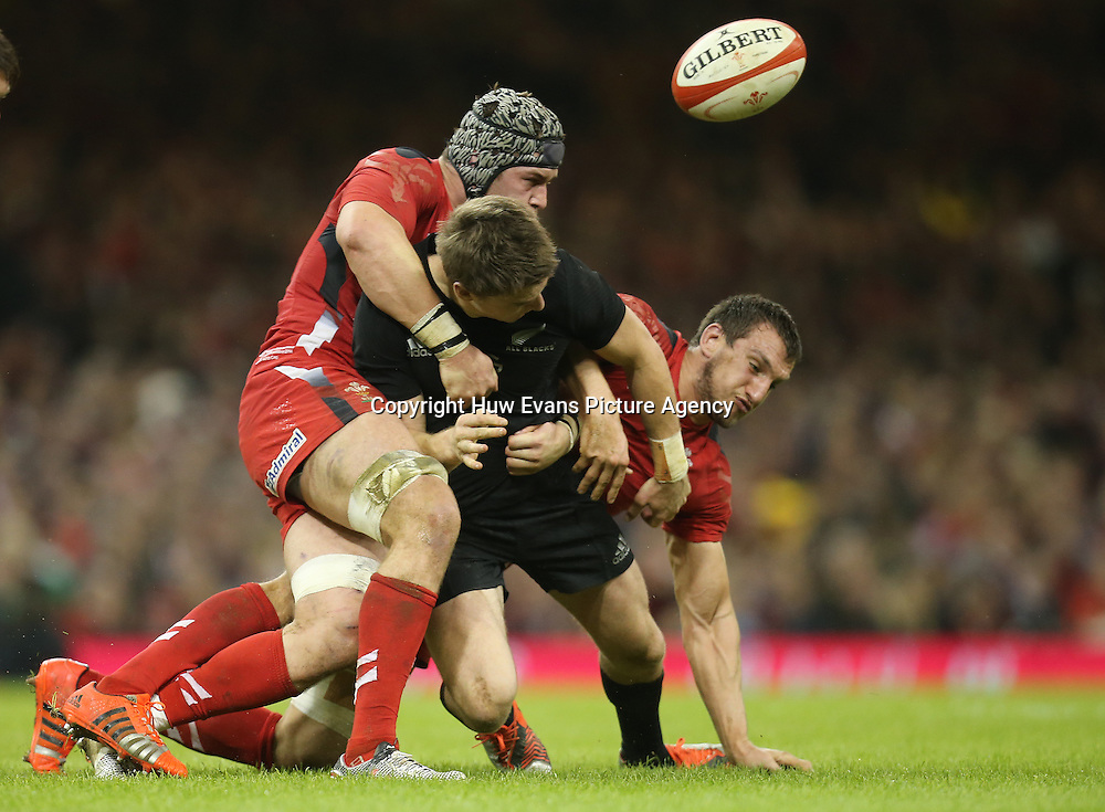 22.11.14 -  Wales v New Zealand, Dove Men Series 2014, Cardiff - <br /> Beauden Barrett of New Zealand is tackle by Dan Lydiate of Wales and Sam Warburton of Wales   <br /> &copy; Huw Evans Agency, Cardiff