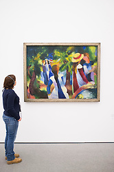 Woman looking at painting Madchen unter den Baumen by August Macke at Pinakothek Moderne art museum in Munich Germany