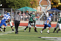 12 October 2013:  Devonte Jones offers protection for Rob Gallik who is in the pocket to pass during an NCAA division 3 football game between the North Park vikings and the Illinois Wesleyan Titans in Tucci Stadium on Wilder Field, Bloomington IL