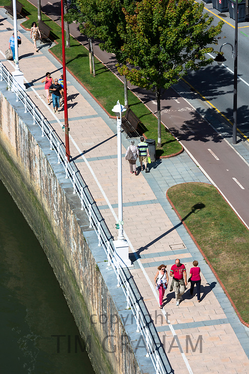 People strolling along the river front in Bilbao, Basque Province, Spain