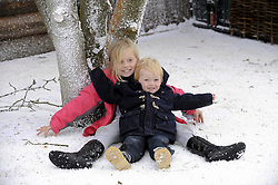 © Licensed to London News Pictures. 26/11/2011. Lamberhurst ,UK. Brother and Sister Olly and Ellie Jackson enjoy playing in fake snow on the opening day of LaplandUK  in Lamberhurst, Kent today (26/11/2011). The park which is recreated from scratch every year, recreates Father Christmas' arctic homeland. Photo credit : Grant Falvey/LNP