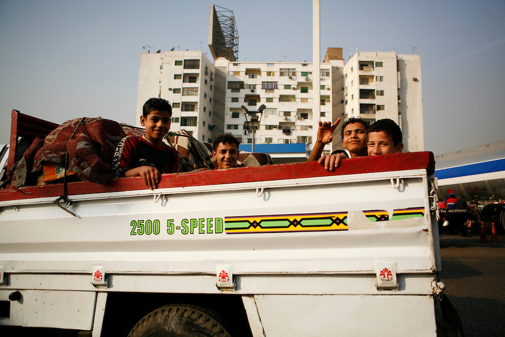 Boys in the back of a pickup truck, Cairo.
