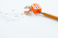 Orange pencil with orange pencil sharpener and shavings