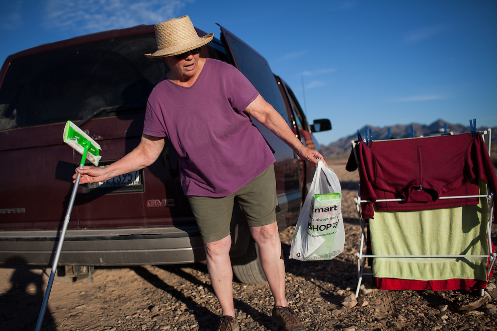 Author LaVonne Ellis does some cleaning while camping in the desert outside Eherenberg, Arizona.