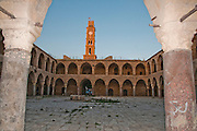 Israel, Acre, The clock tower and walls of the old hostel Khan el Omdan as seen from within the courtyard