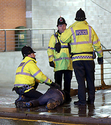 "© licensed to London News Pictures. Manchester, UK 17/12/2011. Police move a man in to recovery position and wait for an ambulance. Despite freezing temperatures, ""Mad Friday"" revellers in Manchester enjoy what is traditionally the busiest night of the year for emergency services, before Christmas. Police rush to the aid of a man who has collapsed in the street as worried friends look on. Photo credit: Joel Goodman/LNP"
