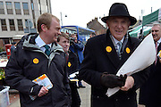 © Licensed to London News Pictures. 21/02/2013. Eastleigh, UK. President of the Liberal Democrats Tim Farron (L) walks with Business Secretary and Liberal Democrat Vince Cable as he holds a bunch of roses  bought from a flower seller whilst campaigning for the  Eastleigh by-election today 21 February 2013. Photo credit : Stephen Simpson/LNP