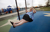 Gabi Jones swings in a park during a photo shoot for her website in a suburb of Denver April 12, 2010.  Jones (not her real name) weighs 502 pounds and is an advocate of size acceptance, using her modeling to inspire those who have low self-esteem.  REUTERS/Rick Wilking  (UNITED STATES)