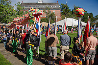 Performers from Way Lum Kung Fu bring blessings through their Dragon dance circling the parade of nations flags at Rotary Park during Saturday's Multi Cultural Festivities.  (Karen Bobotas/for the Laconia Daily Sun)