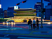 13 JUNE 2018 - SEOUL, SOUTH KOREA: Evening traffic goes around Namdaemun, the South Great Gate in Seoul. The official name of the gate is Sungnyemun, Gate of Exalted Ceremonies, it is one of the Eight Gates in the Fortress Wall of Seoul, South Korea. The gate was built in 1398 and has been rebuilt and renovated several times since then.       PHOTO BY JACK KURTZ