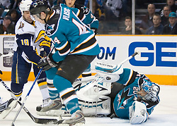 January 23, 2010; San Jose, CA, USA; San Jose Sharks goalie Evgeni Nabokov (20) saves a shot by Buffalo Sabres center Tim Connolly (19) during the first period at HP Pavilion. San Jose defeated Buffalo 5-2. Mandatory Credit: Jason O. Watson / US PRESSWIRE