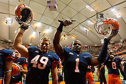 Oct 21, 2011; Syracuse NY, USA;  Syracuse Orange safety Phillip Thomas (1) and fullback Adam Harris (49) celebrate after the game against the West Virginia Mountaineers at the Carrier Dome.  Syracuse defeated West Virginia 49-23. Mandatory Credit: Jason O. Watson-US PRESSWIRE