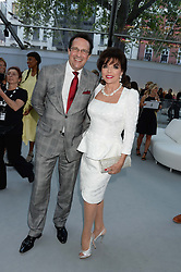 JOAN COLLINS and PERCY GIBSON at the Glamour Women of the Year Awards in association with Pandora held in Berkeley Square Gardens, London on 4th June 2013.