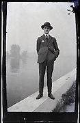 1900s young man standing by river edge
