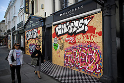 © Licensed to London News Pictures. 23/08/2019. London, UK. Shops boarded up as preparations begin in Notting Hill, West London ahead of the 2018 Notting Hill Carnival which starts this weekend. Warm weather is expected over the bank holiday weekend with carnival attracting over 1 million people to the capital. Photo credit: Ben Cawthra/LNP