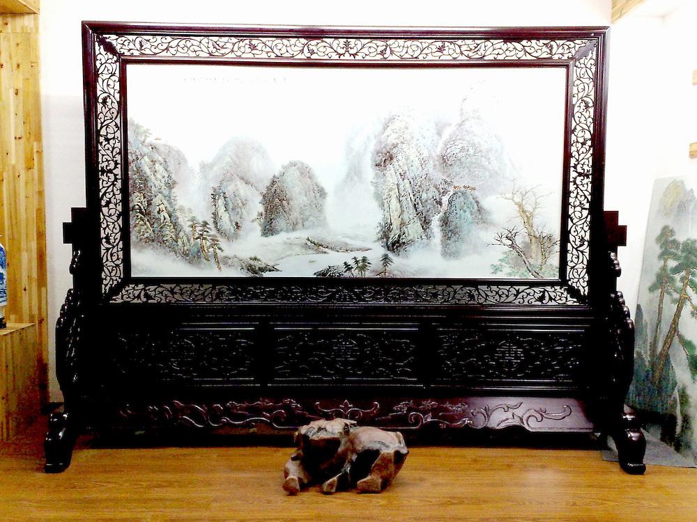 Winter landscape on carved rosewood