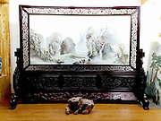 Winter landscape on carved rosewood