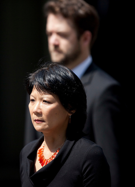 Toronto, Ontario ---11-08-27--- Olivia Chow, wife of Jack Layton walks through the streets of Toronto, Ontario during a funeral procession for her husband, the late NDP leader August 27, 2011. <br /> AFP/GEOFF ROBINS/STR