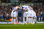 Leeds United players huddle during the EFL Sky Bet Championship match between Leeds United and Aston Villa at Elland Road, Leeds, England on 28 April 2019.