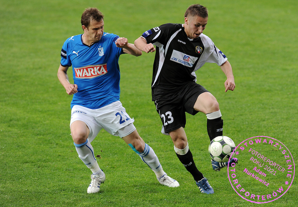 (L) MARCIN KIKUT (LECH POZNAN) & (R) RADOSLAW MAJEWSKI (POLONIA WARSZAWA) DURING SEMI FINAL POLISH CUP SOCCER MATCH BETWEEN POLONIA WARSZAWA AND LECH POZNAN IN SEASON 2008/2009...WARSAW, POLAND , MAY 06, 2009..( PHOTO BY ADAM NURKIEWICZ / MEDIASPORT )..PICTURE ALSO AVAIBLE IN RAW OR TIFF FORMAT ON SPECIAL REQUEST.