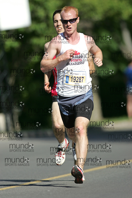 (Ottawa, ON --- May 29, 2010) RYAN SALSBURY running in the 5km race during the Ottawa Race Weekend. Photograph copyright Sean Burges / Mundo Sport Images