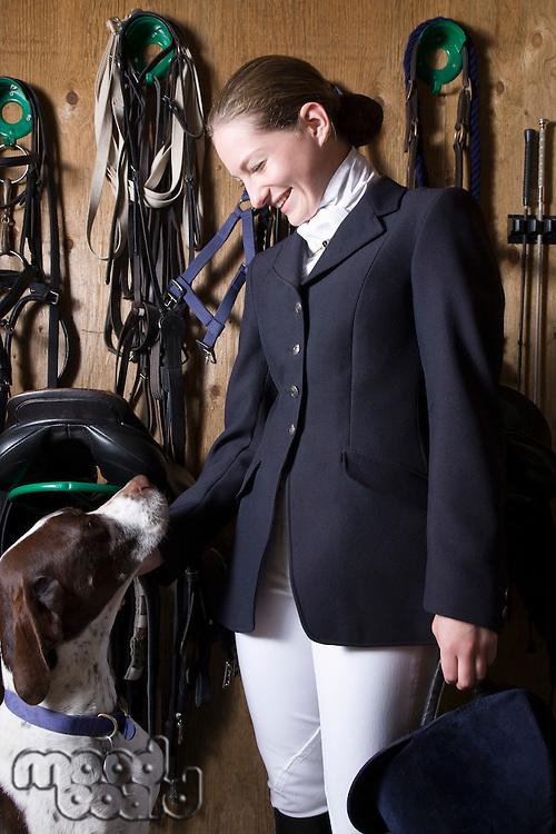Teenage girl with dog indoors