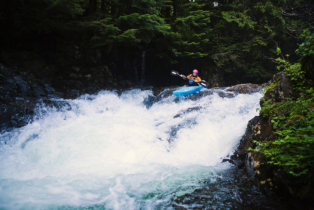 A female kayaker on the Snoqualmie river, Washington, USA.