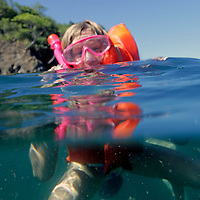 Central America, Costa Rica, Tamarindo. Young girl snorkelling in waters of Costa Rica.