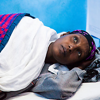 A woman waits to hear the results of lab tests in Motta, Ethiopia.