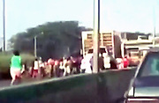 Starving people in Venezuela reduced to stopping truck on motorway and looting it for live chickens<br /> <br /> Venezuela lives an economic and food shortages crises , caused by falling oil prices.According to private studies, shortages of food and medicine in the country reaches 80% of the products, while inflation is growing.<br /> <br /> In that context, there was a shocking looting, where dozens of people stopped a truck that was carrying chickens in full highway to the city of Tocuyito, in the state of Carabobo.<br /> <br /> A video recorded the facts that portray the situation in the country.<br /> <br /> Since June, the Bolivarian National Armed Force (fanbase) controls the production, distribution and marketing of basic foodstuffs, while President Nicolas Maduro faces 75% of public disapproval and opposition offensive for a recall referendum against him.<br /> ©Exclusivepix Media