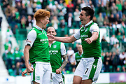 Hibernian forward Simon Murray (#15) and Hibernian midfielder John McGinn (#7) celebrate Hibernian's third goal (3-1) during the Ladbrokes Scottish Premiership match between Hibernian and Partick Thistle at Easter Road, Edinburgh, Scotland on 5 August 2017. Photo by Craig Doyle.