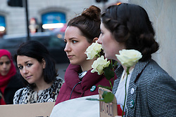 Three women, Joan Crowley, Maeve O'Reilly and Aoife Hamill brave the chilly, damp evening at Marble Arch in London to hold their own #IBelieveHer protest after a rape trial jury in Belfast cleared two Irish rugby stars who boasted online that sex with the same woman was 'like a merry go round'. London, March 29 2018.
