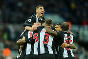 *CORR* Miguel Almiron (#24) of Newcastle United leaps on top of his Newcastle United teammates in celebration of Ciaran Clark (#2) of Newcastle United scoring Newcastle United's second goal (2-1) during the Premier League match between Newcastle United and Bournemouth at St. James's Park, Newcastle, England on 9 November 2019.