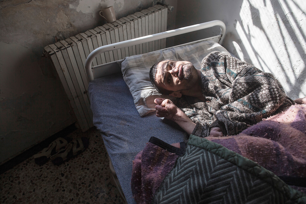 Aleppo, Syria<br /> al-Safaa psychiatric clinic in Aleppo. 54 mentally ill patients from ages 13 to 76 years old are taking cared by three volunteers. All the doctors fled when the war broke out. Many of the patients are forced to eat and sleep in their own and other patients feces.