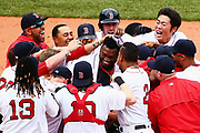Teammates swarm David Ortiz #34 of the Boston Red Sox, center, after hitting his game winning double during the eleventh inning against the Houston Astros on May 14, 2016 in Boston, Massachusetts. The Red Sox defeat the Astros 6-5.