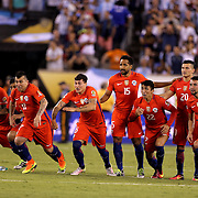 EAST RUTHERFORD, NEW JERSEY - JUNE 26: The Chile players on the half way line celebrate victory after winning the penalty shoot out during the Argentina Vs Chile Final match of the Copa America Centenario USA 2016 Tournament at MetLife Stadium on June 26, 2016 in East Rutherford, New Jersey. (Photo by Tim Clayton/Corbis via Getty Images)