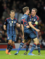 Bayern Munich's Thomas Muller celebrates his goal with Bayern Munich's Philipp Lahm - Photo mandatory by-line: Joe Meredith/JMP - Tel: Mobile: 07966 386802 19/02/2014 - SPORT - FOOTBALL - London - Emirates Stadium - Arsenal v Bayern Munich - Champions League - Last 16 - First Leg