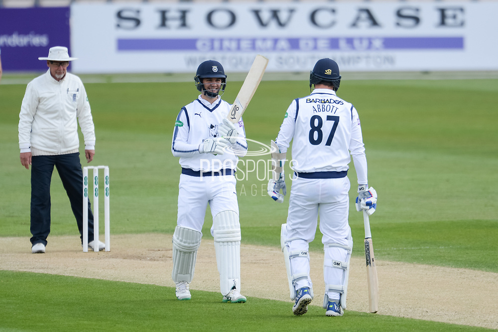 Rilee Rossouw and Kyle Abbott of Hampshire during the Specsavers County Champ Div 1 match between Hampshire County Cricket Club and Middlesex County Cricket Club at the Ageas Bowl, Southampton, United Kingdom on 16 April 2017. Photo by David Vokes.