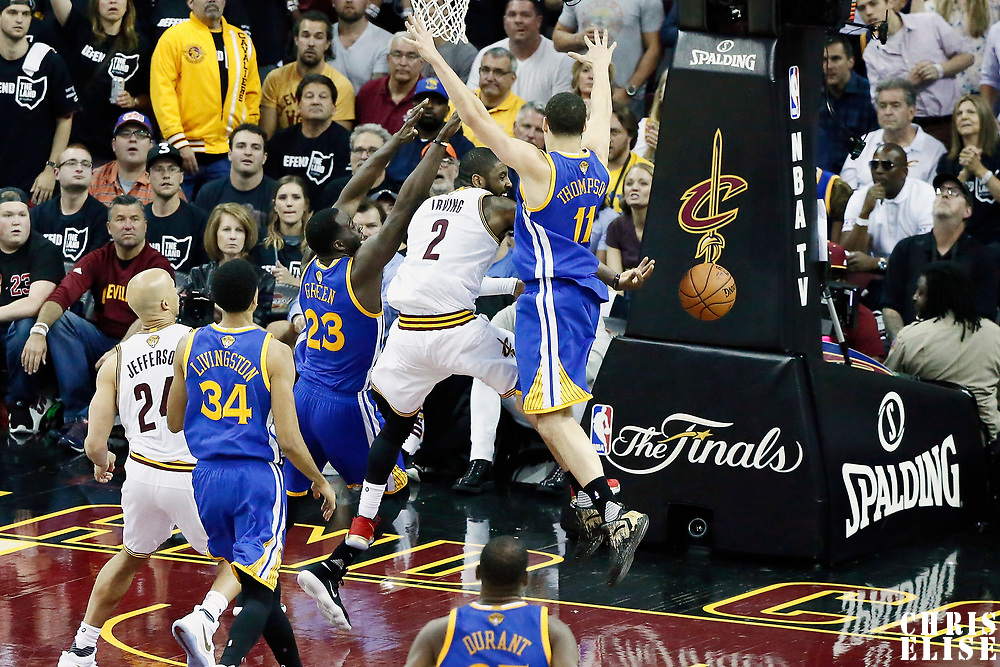 09 June 2017: Cleveland Cavaliers guard Kyrie Irving (2) passes the ball around Golden State Warriors guard Klay Thompson (11) during the Cleveland Cavaliers 137-11 victory over the Golden State Warriors, in game 4 of the 2017 NBA Finals, at  the Quicken Loans Arena, Cleveland, Ohio, USA.